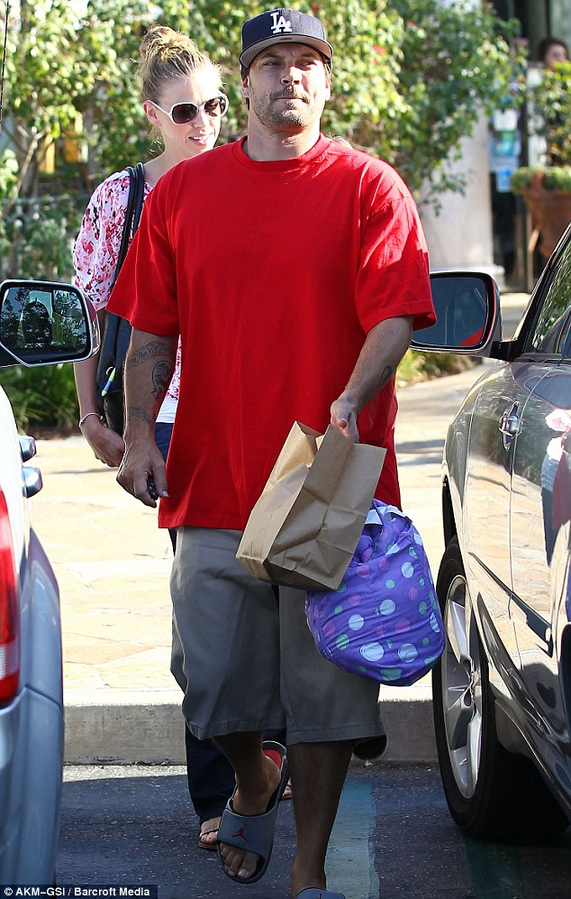 Leading the way: Kevin carried the bags and led the way back to the family car