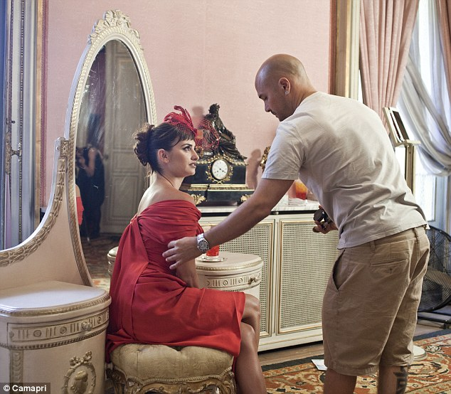 Got to look her best: The actress was seen sitting at a dressing table as male make-up artist touched up her face