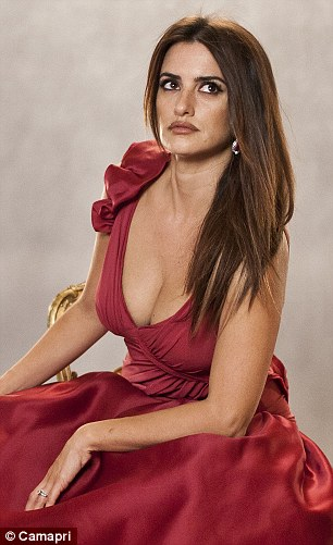 Lady in red: Cruz looked sexy and sophisticated in the bold colour