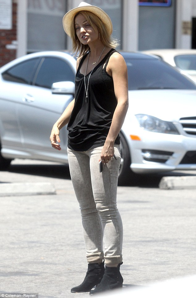 Happy: Mena Suvari stepped out with a new male companion today in West Hollywood