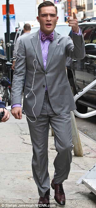From drab to dapper: Westwick later changed into his more familiar suited garb as Gossip Girl character Chuck Bass