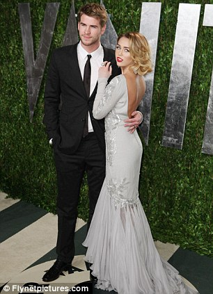 So happy together? The couple with Ziggy and at the Vanity Fair Oscars party in February