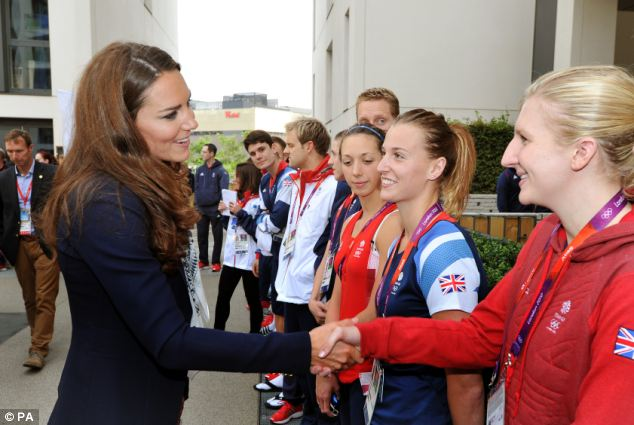 Just dropping in: The Duchess of Cambridge laughs as she talks with Great Britain swimmer Rebecca Adlington during a visit to the Team GB accommodation flats in the Athletes Village at the Olympic Park in Stratford, east London