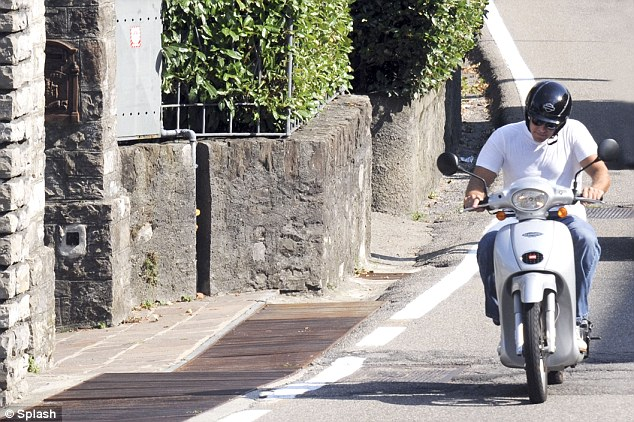 Cruising around: The actor is on an extended vacation in Lake Como where he has been since June