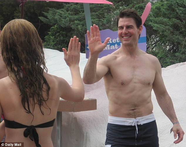 High five: The Hollywood star stripped down to a pair of shorts and happily greeted star-struck fans