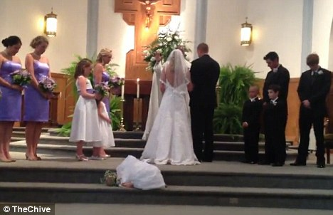 'Til nap do us part: The flower gilr slid down and settled for a snooze right behind the bride at the altar