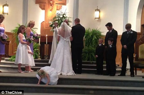 Going rogue: With the ceremony in full swing, little Claire Miller decided that the nuptials have gone long enough