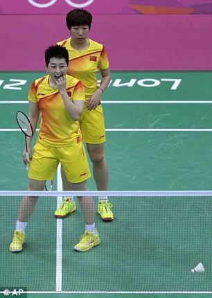 World doubles champions Yu Yang (front) and Wang Xiaoli, of China, watch as the shuttlecock yet again lands int he net