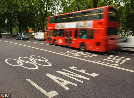 Running smoothly: Traffic moves freely alongside Olympic lanes on Park Lane, during the morning rush hour in central London