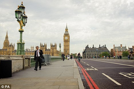 Quiet: Westminster Bridge appears almost empty of pedestrians and vehicles during morning rush hour in central London