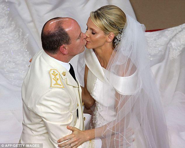 Prince Albert II of Monaco kisses Princess Charlene of Monaco during their lavish wedding at the Main Courtyard of the Prince's Palace