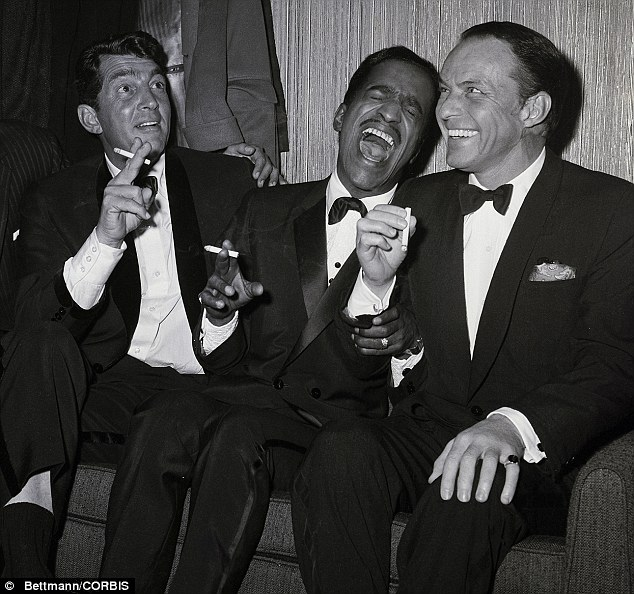 Party time (l-r): Dean Martin, Sammy David Jr and Frank Sinatra relax off-stage in 1961. The Rat Pack were regulars at Sinatra's home