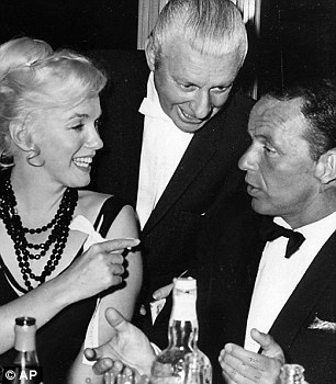 Famous friends: Marilyn Monroe with the crooner in the 1960s. She too was a guest at the apartment