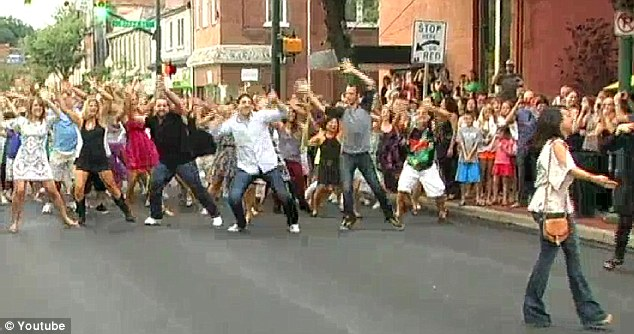 Attention! Joey Lanianese of Sewickley, Pennsylvania, proposed to Alex DeLoia on Saturday with the help of about 300 dancers and friends