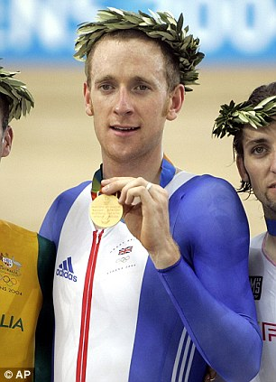 Centre of attention: Wiggins celebrates gold in Athens