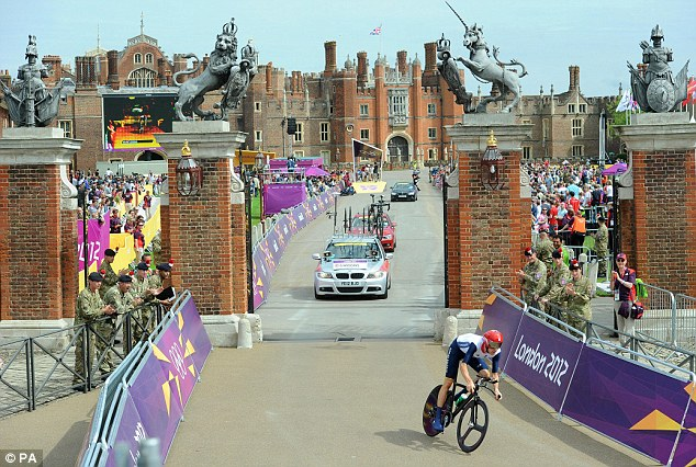 And he's off: Bradley Wiggins starts his bid for time trial glory at Hampton Court Palace