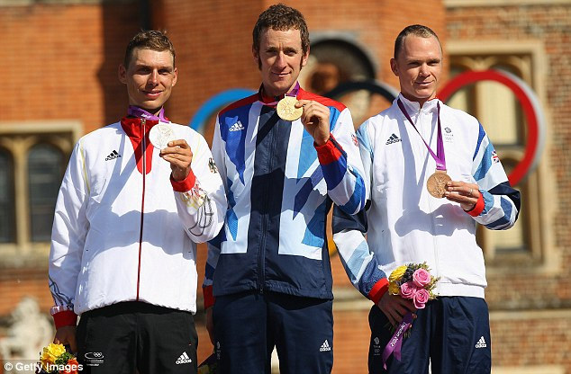 Glittering career: Bradley Wiggins shows off his gold medal with Tony Martin (left) and Chris Froome