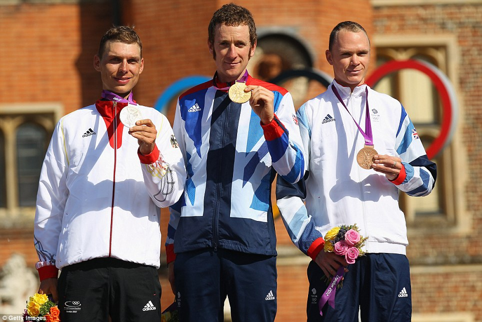 The top three show off their precious metal after the time trial. The medals lifted Britain to tenth in the overall table