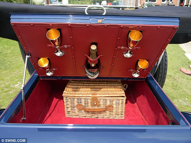 Fully equipped: The Rolls-Royce comes complete with a picnic basket containing champagne and silver goblets