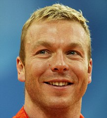 Great Britain's Chris Hoy with the three gold medals he won at the 2008 Beijing Olympic Games