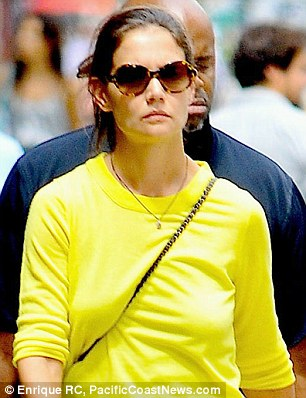 Glum: Katie Holmes out on her own in New York yesterday