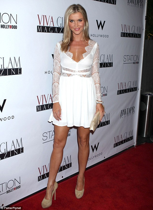 Angelic: Real Housewives Of Miami star Joanna Krupa looked positively heavenly in a white minidress as she attended the Viva Glam Magazine September Issue Launch Party held at W hotel in Hollywood last night