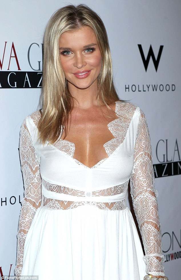Flawless: Joanna's deep tan from never-ending days under the sun was off-set from the stark white hue