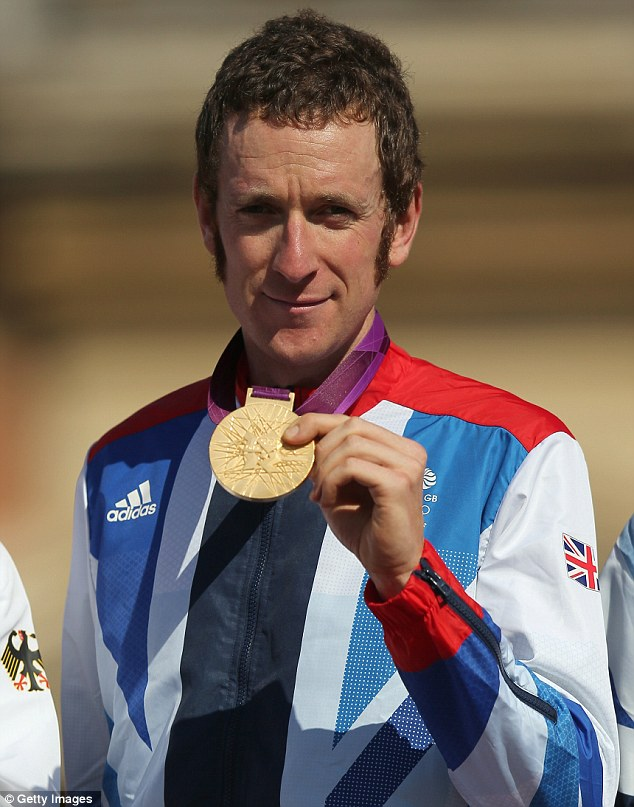 Gold medallist - and owner of Britain's most famous sideburns - Bradley Wiggins celebrates after the Men's Individual Time Trial Road Cycling