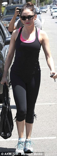 Back to black: Rose sported a black vest top, cropped workout pants and white trainers for her exercise session