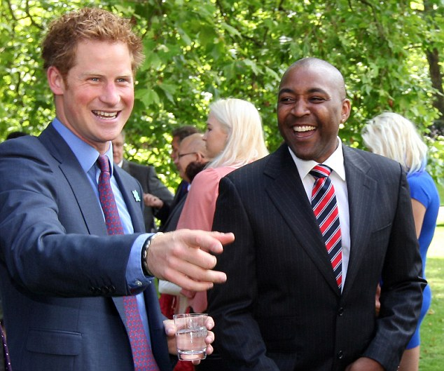 Joker: Prince Harry raises a laugh from former sprinter Daren Campbell at a reception at Clarence House