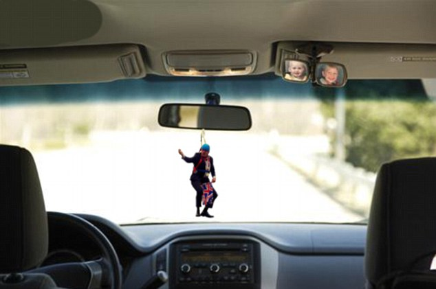 Rear view mayor: Mr Johnson hangs from a car mirror in another internet pranksters effort