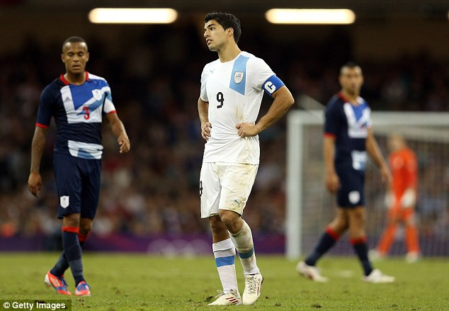 Don't do that: Luis Suarez hated the boos from Team GB fans, as Uruguay were eliminated (below)