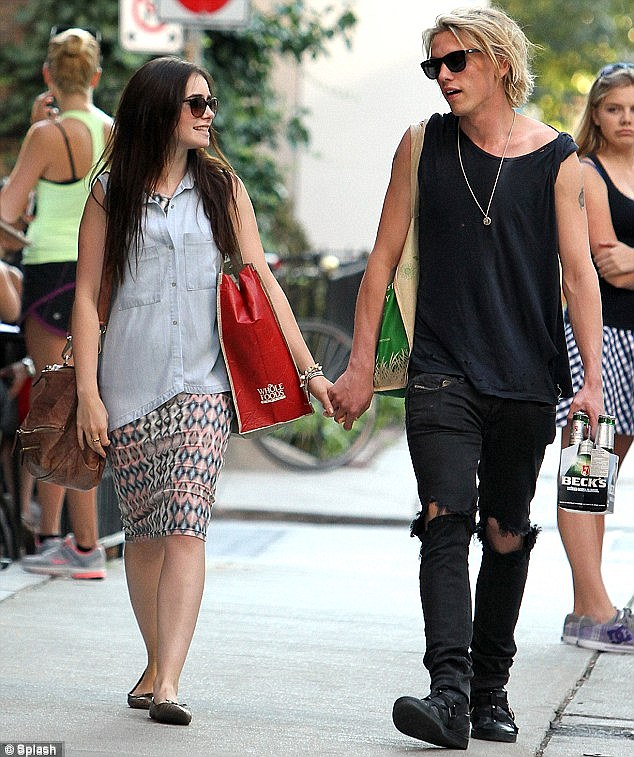 Budding romance? Lily looked close to her The Mortal Instruments co-star Jamie Campbell Bower as they strolled hand in hand through Toronto, Canada, last month