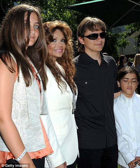 Auntie: La Toya poses with Michael's three children Paris, Prince at the Children's Hospital Los Angeles for a Michael Jackson artwork donation ceremony last August