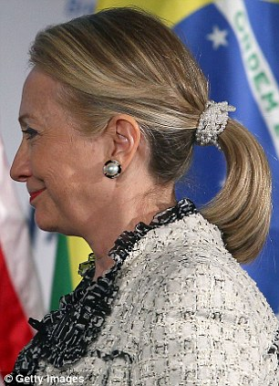 Hillary Clinton wearing a pearl scrunchie at the Chamber of Commerce