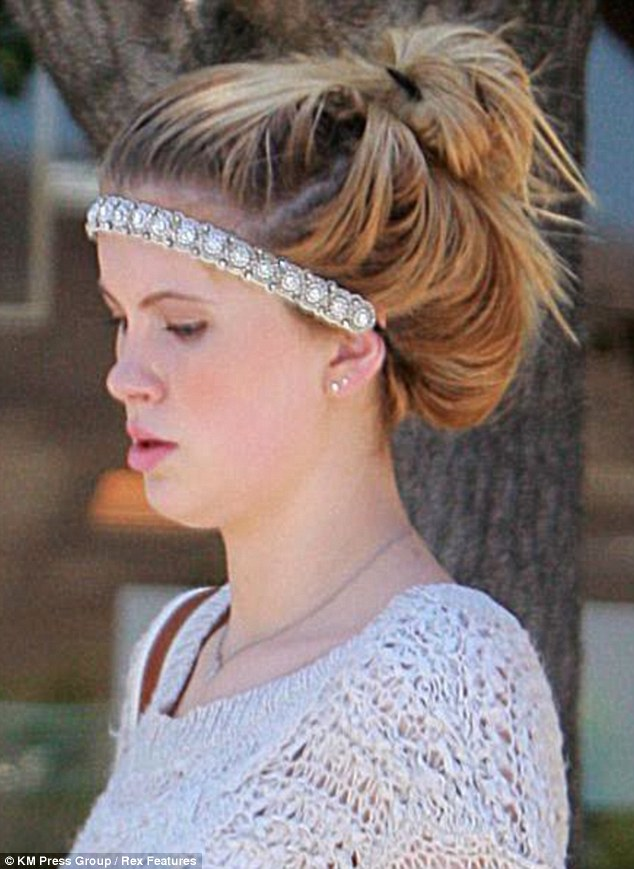 Feminine: The 16-year-old wore a pretty hippie headband suited to a music festival