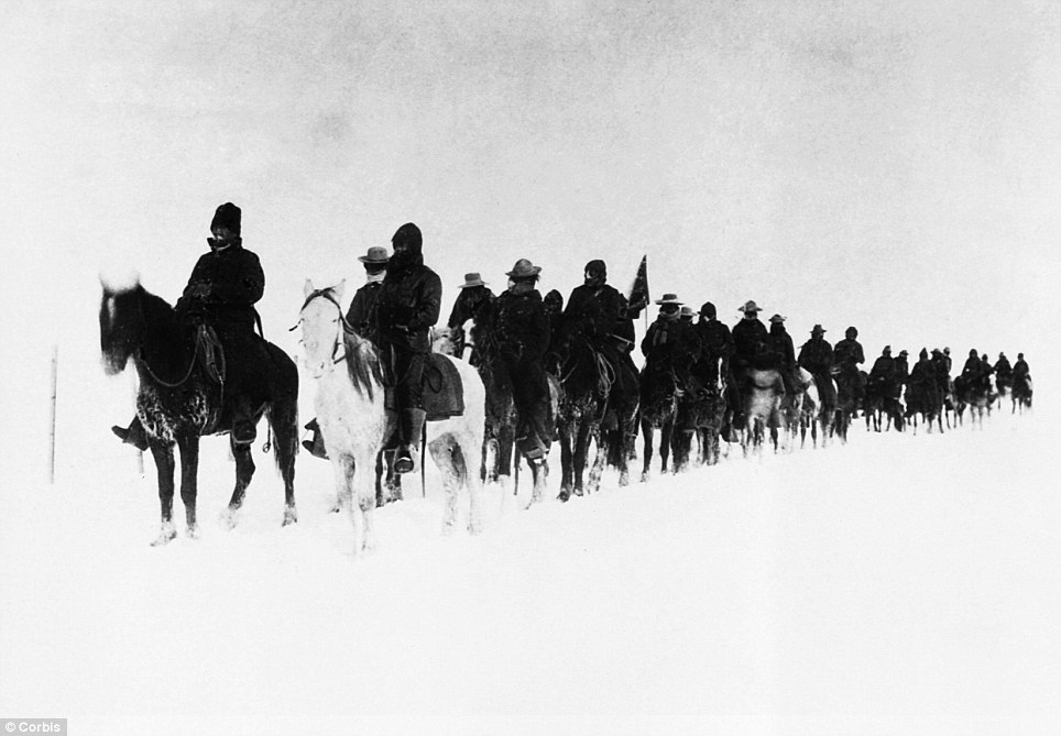 The winter of 1890-1891, South Dakota, USA --- Return of scouts from the fight at Wounded Knee.  Soldiers on horseback plod through the snow in a line