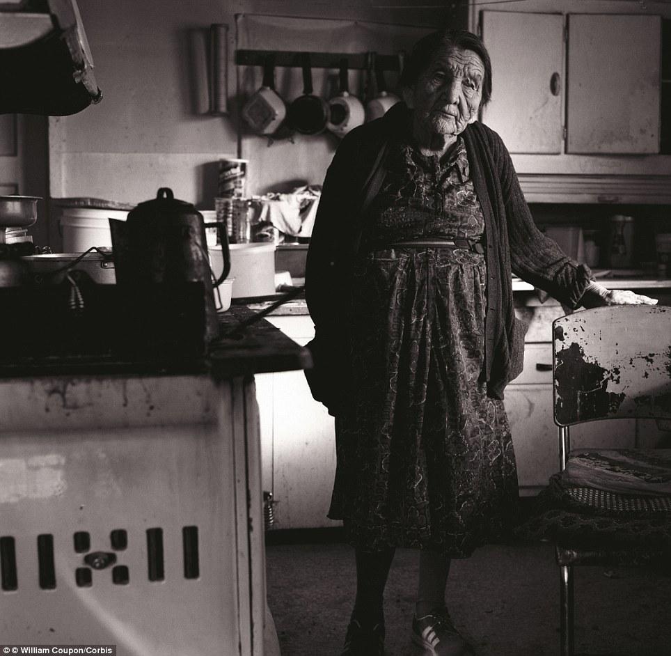 Pine Ridge Indian Reservation, South Dakota, USA --- Elderly Lakota Souix Woman in Kitchen