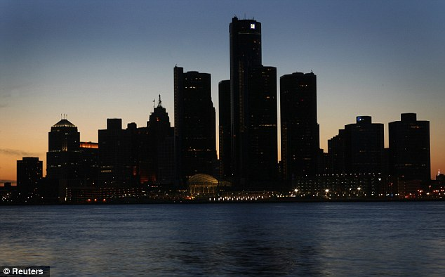 Residents: The Detroit skyline is shown while about a quarter-million people moved out of Detroit between 2000 and 2010, leaving just over 700,000 residents in a city built for 2 million