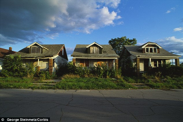 In the shadows: Detroit has more than 30,000 vacant houses, a few seen here, and the deficit-strangled city has no resources of its own to level them allowing crime to be that much easier to occur and cover up