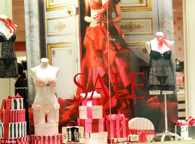 A typical window display at a Victoria's Secret store featuring negligees, frilly briefs and push-up bras