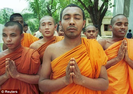 Old practice: Buddhist monks have been perfecting the art of meditation for thousands of years