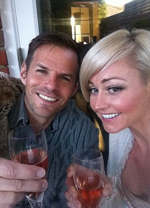 Happier times: The pair celebrating their wedding anniversary back in May
