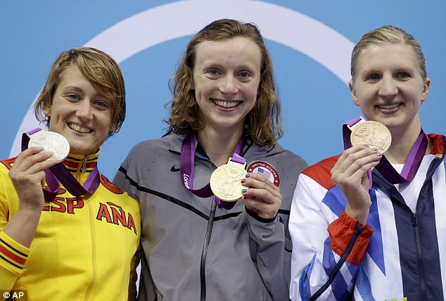 Happiness: Ledecky poses with silver medalist Mireia Belmonte Garcia, left, from Spain and bronze medalist Rebecca Adlington from Britain