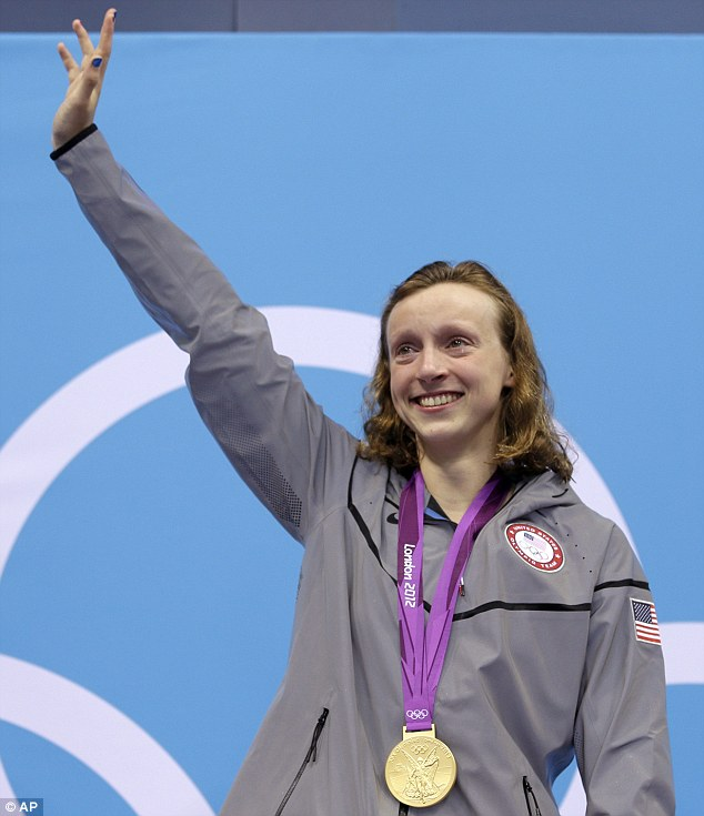 Emotional: With tears in her eyes, Ledecky waves from the podium after winning her gold medal