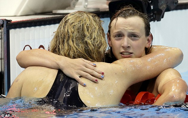 Disbelief: Ledecky, pictured hugging Adlington, said the Olympics were never on her radar