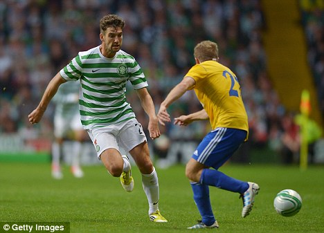 Out: Charlie Mulgrew (left) has been ruled out of Celtic's curtain raiser against Aberdeen
