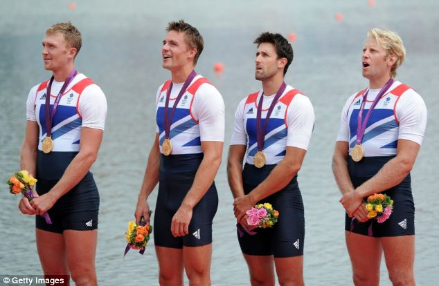 Winning team: The men smiled widely during the medal ceremony for the Men's Four Final on Day 8 of the London 2012 Olympic Games at Eton Dorney