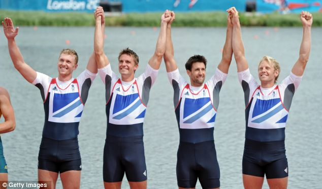 Triumphant: Great Britain take a bow in front of the crowd before receiving their gold medals