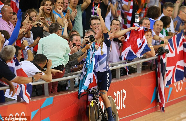 Party time: Laura Trott of Great Britain celebrates winning the gold medal and breaking the world record